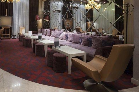 Fancy seating area of a hotel with purple sofas
