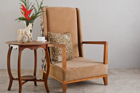 low style brown fabric chair with side table